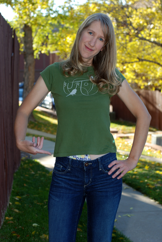 When I wear t-shirts with shorter hem lines, my pouch often shows above my jean waistband.