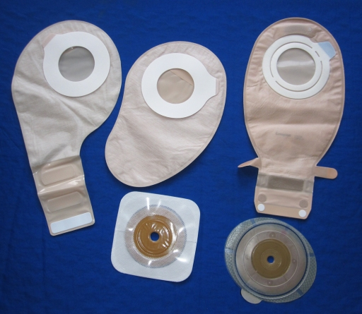 In adhesive coupling two-piece systems, the wafers and pouches stick together with an sticky ring. They are low profile, but I find them messy to swap out when on outdoor trips.