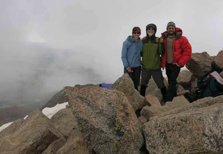 On the summit of Mt. Bierstadt at 9:30 a.m. in what we thought was just a rogue misty fog cloud rolling through. Moments after this photo was taken, Doug's hair started to stand on end and our poles started buzzing. We never ran so fast down a mountain.