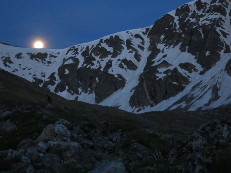 Gorgeous views often come with early starts. The moon sets over the saddle between Grays and Torreys peaks.