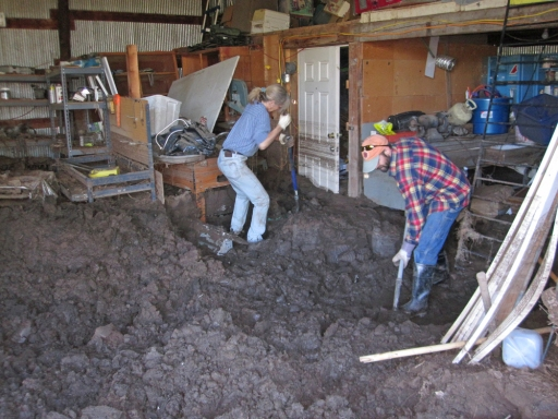 Doug tackles the mud in the barn.