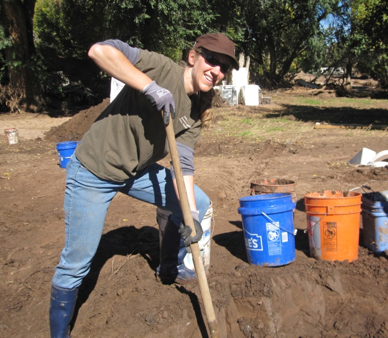 Moving countless buckets of mud as a flood relief volunteer.