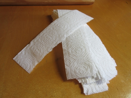 The only supplies needed for a stoma hat are one-inch-wide strips of paper towel.